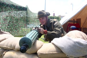 Michael McGilliuray from the 11th Battallion Living History Unit mans the machine gun for the Australia day foreshore celebration.