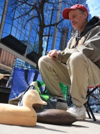 Ross Ramirez carves hunting decoys along Yonge street, Toronto, ON - a hobby he's had since childhood. Taken 20th of March, 2015.